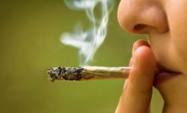 smoking a marijuana joint