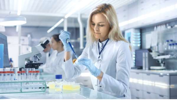 Laboratory technician performing genetic tests