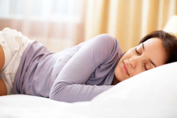 woman asleep on bed